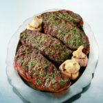 New York Steaks with Roasted Garlic Pesto